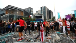 England fans knock down barriers on Wembley Way