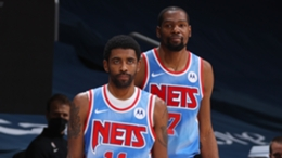 Brooklyn Nets team-mates Kyrie Irving (L) and Kevin Durant (R)