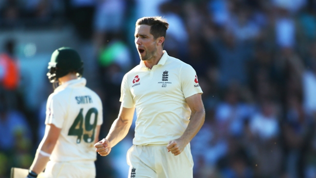 England seamer Chris Woakes celebrates dismissing Steve Smith at The Oval