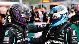 Mercedes team-mates Lewis Hamilton (L) and Valtteri Bottas (R)