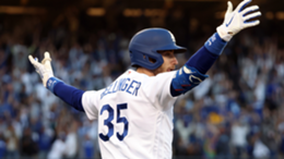 Cody Bellinger #35 of the Los Angeles Dodgers reacts as he hits a 3-run home run during the 8th inning of Game 3 of the National League Championship Series against the Atlanta Braves