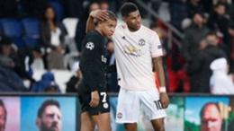 PSG's Kylian Mbappe (L) and Marcus Rashford (R)