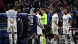 PSG's Achraf Hakimi (second left) receives a red card against Marseille
