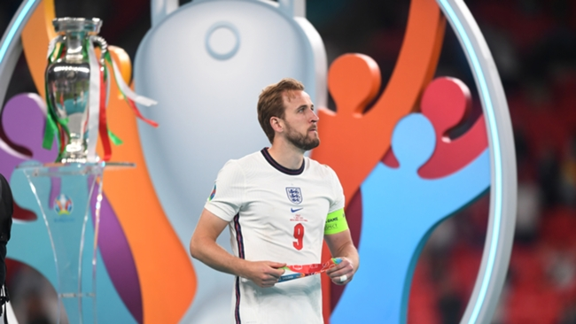 Harry Kane picks up his runners-up medal following England's loss to Italy