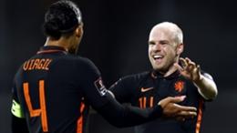 Davy Klaassen (R) celebrates with Netherlands captain Virgil van Dijk