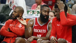 James Harden, center, with Clint Capela, right, and Chris Paul