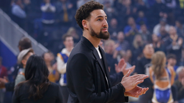 Klay Thompson #11 of the Golden State Warriors looks on before the game against the Detroit Pistons at Chase Center