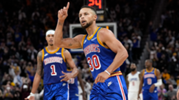 Stephen Curry #30 of the Golden State Warriors celebrates after he made a three-point basket against the LA Clippers late in the fourth quarter