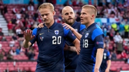 Finland's Jeol Pohjanpalo (left) refuses to celebrate his goal against Denmark following the collapse of Christian Eriksen