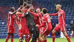 Alisson celebrates his late winner