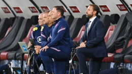 Gareth Southgate and his staff take the knee in Budapest