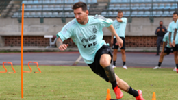 Lionel Messi of Argentina warms up during a training session ahead of the match against Venezuela