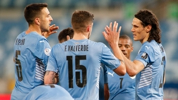 Uruguay's players celebrate after Carlos Lampe's own goal in the win over Bolivia