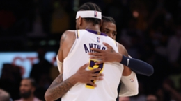 Carmelo Anthony hugs Ja Morant after the Lakers beat the Grizzlies