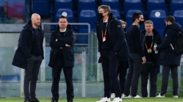 Erik ten Haag (left) expects Marc Overmars (second left) to stay at Ajax