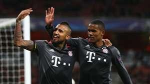 Douglas Costa and Arturo Vidal of Bayern Munich