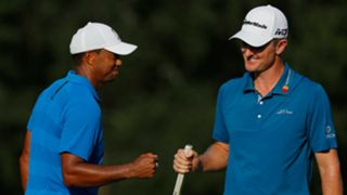 Justin Rose, right, and Tiger Woods