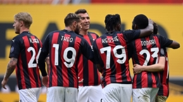 Milan celebrate their winner against Genoa