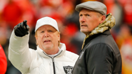 Las Vegas Raiders owner Mark Davis, left, watches his team during warmups with Oakland Raiders general manager Mike Mayock