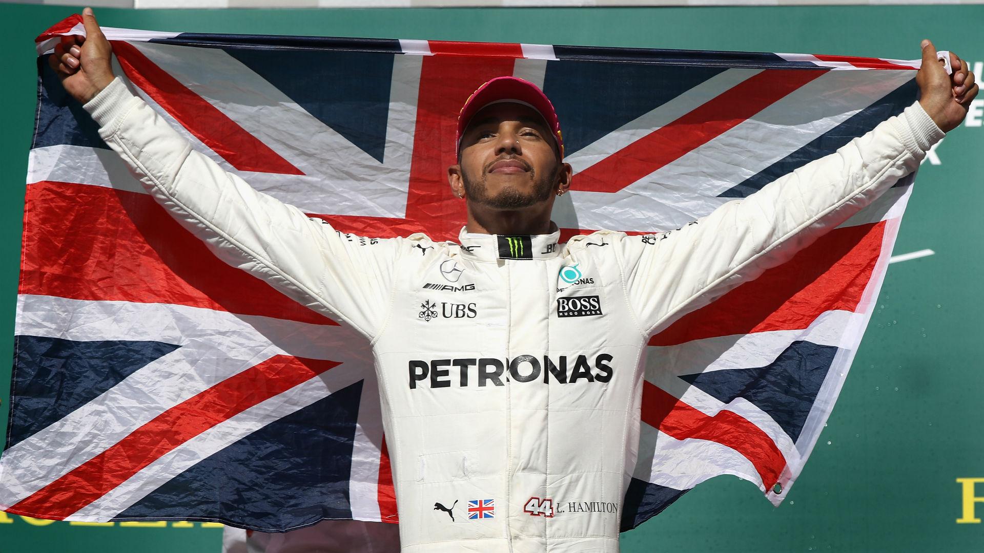 Lewis Hamilton wins fourth F1 title despite first-lap collision with Sebastian Vettel