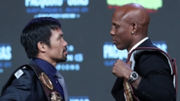 Manny Pacquiao (L) and Yordenis Ugas size each other up before fight night