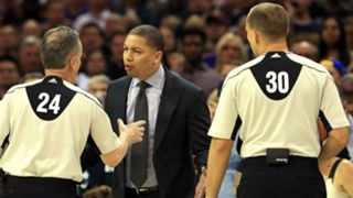 Tyronn Lue argues with Mike Callahan (24) and John Goble