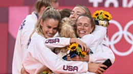 The United States team celebrate their volleyball gold medal