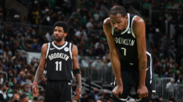 Kevin Durant #7 of the Brooklyn Nets and Kyrie Irving #11 look on during the game against the Boston Celtics