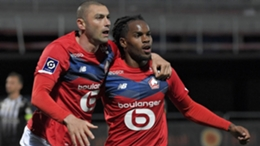 Burak Yilmaz (L) after scoring for Lille against Angers