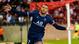 Kylian Mbappe celebrates after scoring for PSG against Reims in Ligue 1.