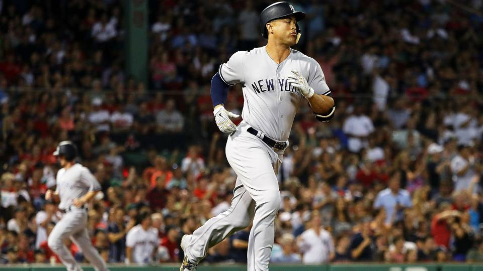 Yankees' Giancarlo Stanton smiles and waves after being hit with own HR ball