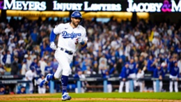 Chris Taylor #3 hits a solo home run in the seventh inning during Game 5 of the NLCS between the Atlanta Braves and the Los Angeles Dodgers at Dodgers Stadium