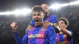 Barcelona players celebrate Gerard Pique's goal against Dynamo Kiev