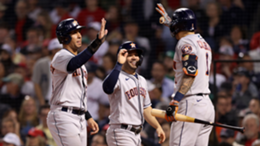 Jose Altuve #27 and Michael Brantley #23 of the Houston Astros are congratulated by Carlos Correa #1 after they scored against the Boston Red Sox in the sixth inning of Game Five of the American League Championship Series at Fenway Park