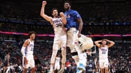 Joel Embiid (R) and the Philadelphia 76ers celebrate on opening night
