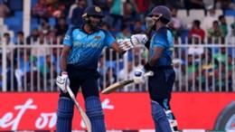 Bhanuka Rajapaksa (left) and Charith Asalanka touch gloves