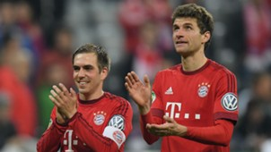 Philipp Lahm (L) and Thomas Muller (R)