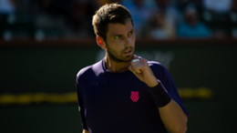 Cameron Norrie of Great Britain celebrates his victory over Grigor Dimitrov of Bulgaria in the semifinal of the BNP Paribas Open at the Indian Wells Tennis Garden
