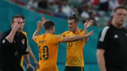 Aaron Ramsey (l) and Gareth Bale celebrate against Turkey