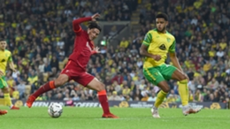Takumi Minamino scores his second and Liverpool's third goal at Norwich