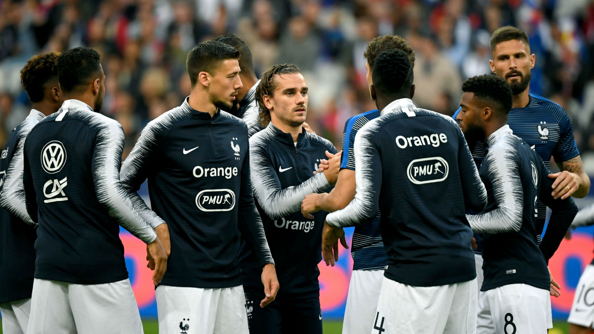 France ease past Albania after anthem farce