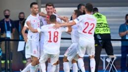 Spain's players celebrate Aymeric Laporte's goal against Slovakia