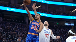 Stephen Curry #30 of the Golden State Warriors shoots and scores over Ivica Zubac #40 of the LA Clippers