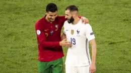 Cristiano Ronaldo embraces Karim Benzema