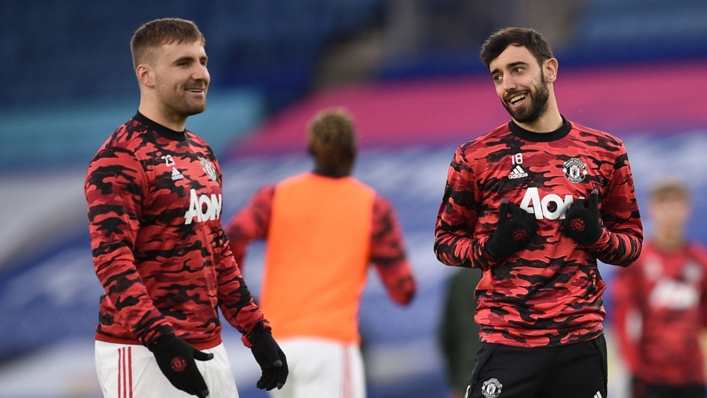 Luke Shaw and Bruno Fernandes of Manchester United