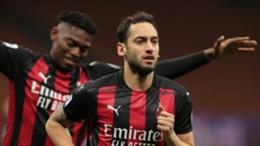 Milan midfielder Hakan Calhanoglu celebrates scoring against Benevento