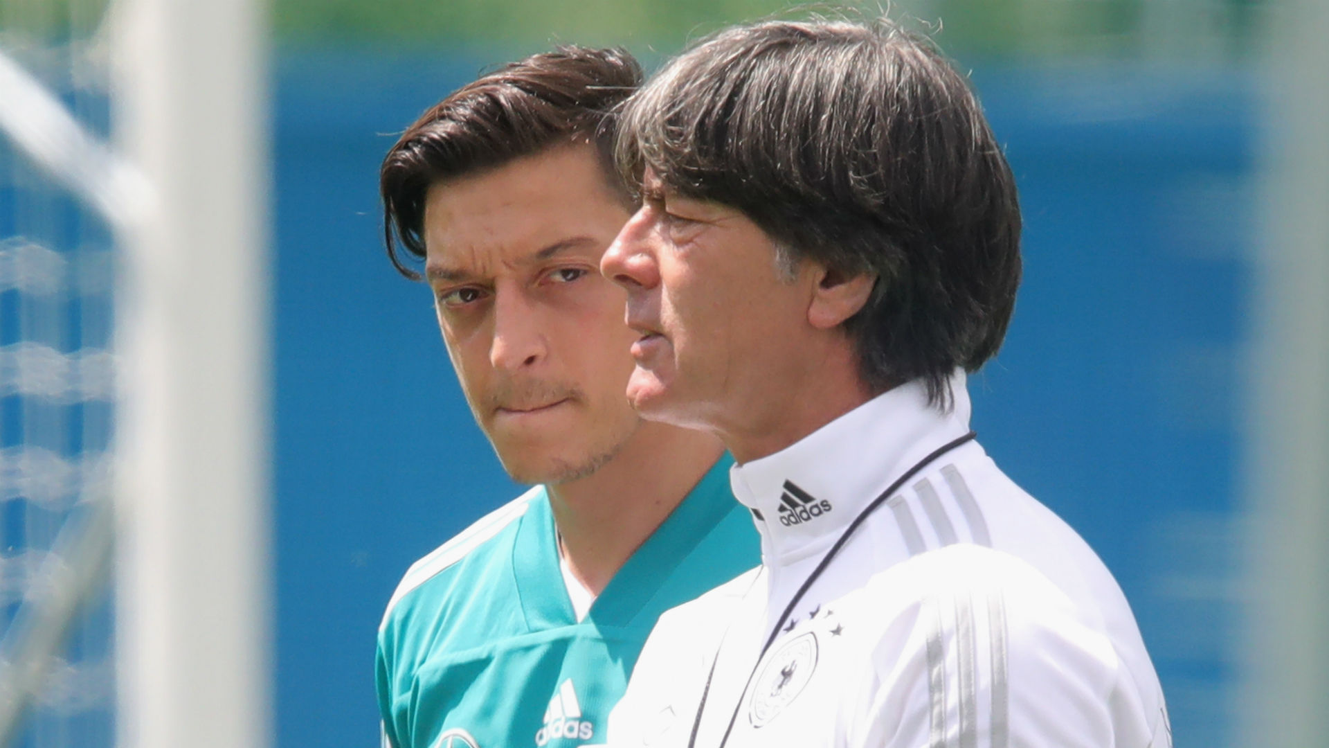 Mesut Ozil and Joachim Low- cropped