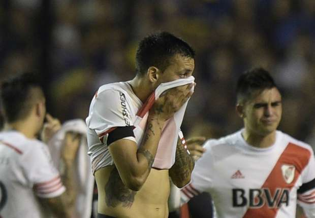 The Copa Libertadores last 16 second leg between Boca Juniors and River Plate was suspended after pepper spray was used on the visitors. - Goal.com