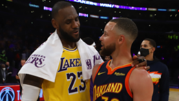 LeBron James #23 of the Los Angeles Lakers talks with Stephen Curry #30 of the Golden State Warriors after the game during the Play-In Tournament