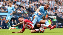 Adam Armstrong goes down under a challenge from Kyle Walker